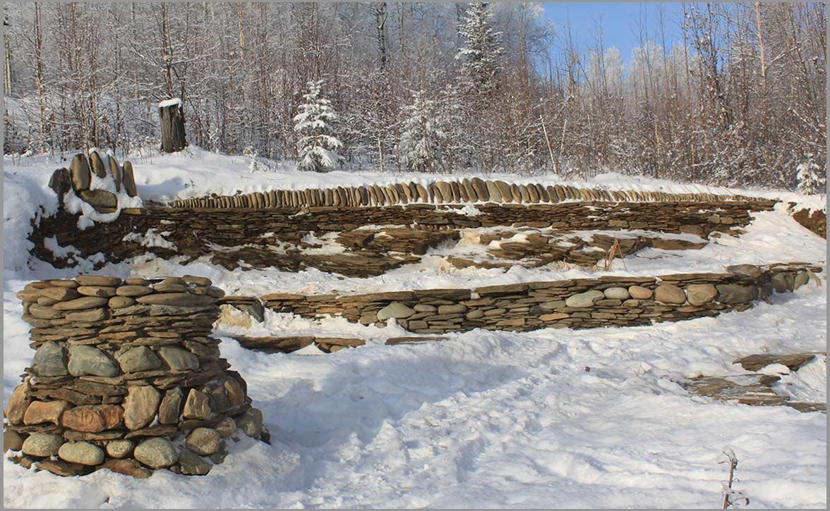 Winter view of the stone bear paw at theStone Sanctuary Fairbanks Alaska