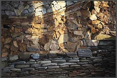 Sunlight on the stone wall at the cabin at the stone sanctuary in Fairbanks, Alaska