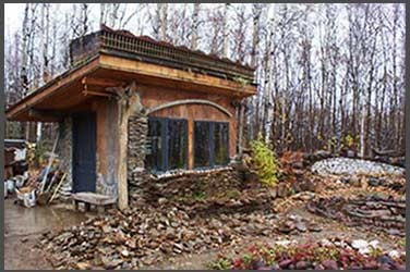 Cabin with a schist exterior at the stone sanctuary in Fairbanks, Alaska